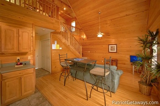 Dining area with table for two at Quality Time, a 1 bedroom cabin rental located in Gatlinburg