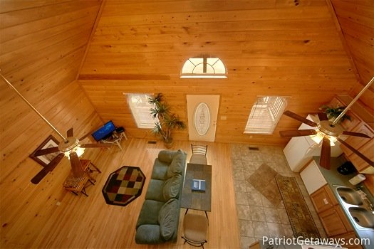 Living room view from loft at Quality Time, a 1 bedroom cabin rental located in Gatlinburg