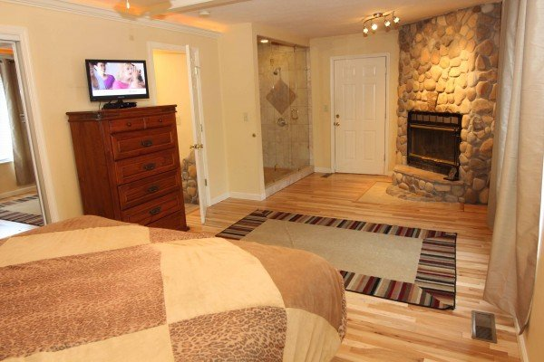 Stone fireplace in the bedroom at Quality Time, a 1 bedroom cabin rental located in Gatlinburg