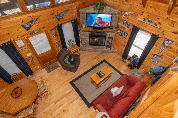 Living room from the second floor at Nascar Nation, a 2 bedroom cabin rental located in Pigeon Forge