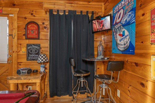 Bar table in the game room corner at Nascar Nation, a 2 bedroom cabin rental located in Pigeon Forge