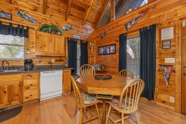 Dining table for 4 at Nascar Nation, a 2 bedroom cabin rental located in Pigeon Forge