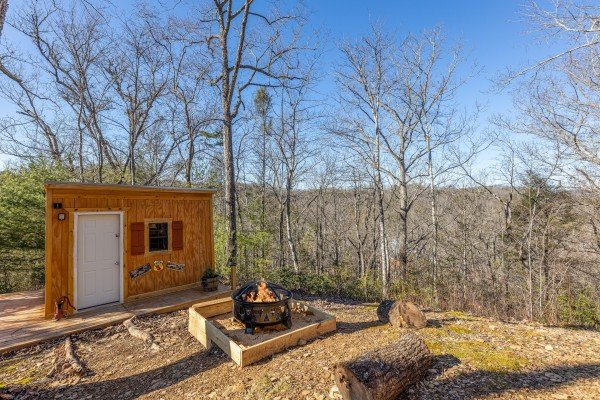 Fire pit at Nascar Nation, a 2 bedroom cabin rental located in Pigeon Forge