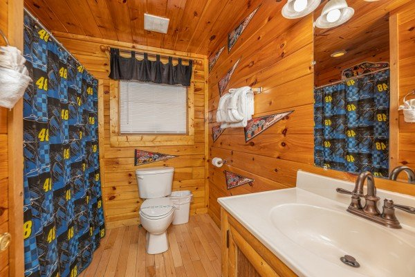 Bathroom with shower and tub at Nascar Nation, a 2 bedroom cabin rental located in Pigeon Forge