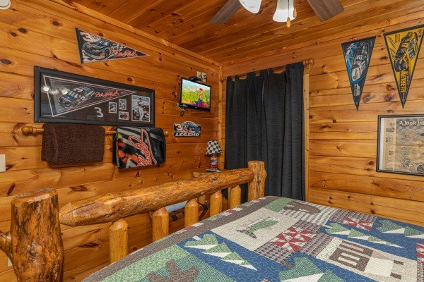 TV in a bedroom at Nascar Nation, a 2 bedroom cabin rental located in Pigeon Forge