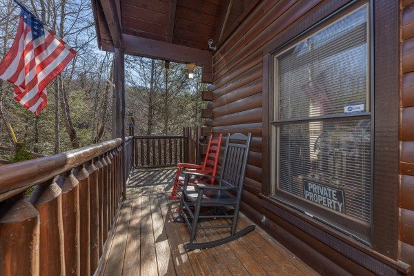 Front porch with rocking chairs at Nascar Nation, a 2 bedroom cabin rental located in Pigeon Forge