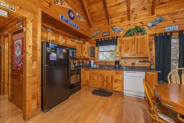 Kitchen with black and white appliances at Nascar Nation, a 2 bedroom cabin rental located in Pigeon Forge
