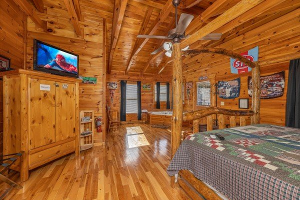 Armoire, TV, and jacuzzi in a bedroom at Nascar Nation, a 2 bedroom cabin rental located in Pigeon Forge