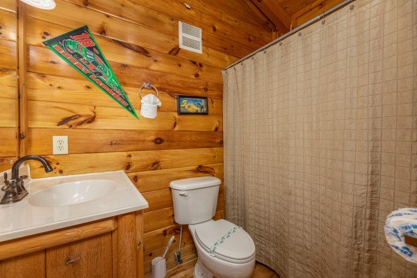 Bathroom with tub and shower at Nascar Nation, a 2 bedroom cabin rental located in Pigeon Forge