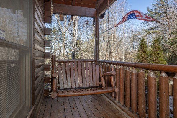 Swing on the front porch at Nascar Nation, a 2 bedroom cabin rental located in Pigeon Forge