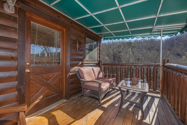 Deck off the loft bedroom at Nascar Nation, a 2 bedroom cabin rental located in Pigeon Forge
