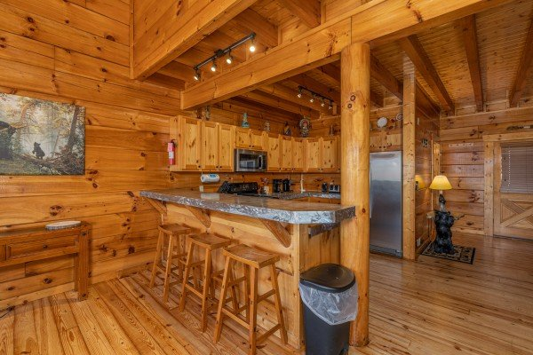 Breakfast bar with three stools at La Kiara a 3 bedroom cabin rental located in Pigeon Forge