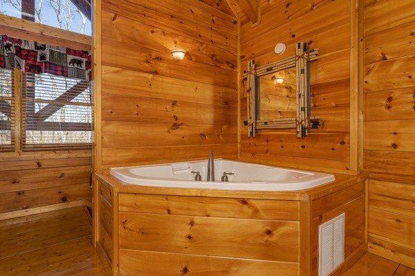Jacuzzi in a bedroom at La Kiara a 3 bedroom cabin rental located in Pigeon Forge