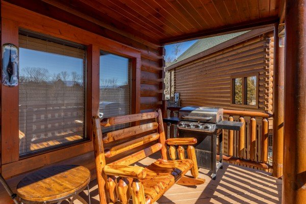 Deck and grill at La Kiara a 3 bedroom cabin rental located in Pigeon Forge