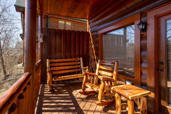 Rocking chairs on a deck at La Kiara a 3 bedroom cabin rental located in Pigeon Forge