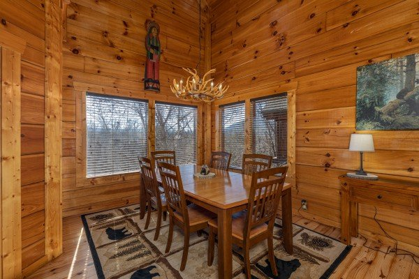 Dining table with six chairs at La Kiara a 3 bedroom cabin rental located in Pigeon Forge
