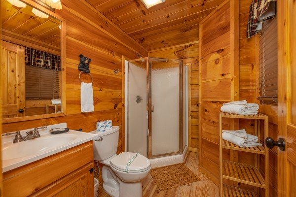 Bathroom with a corner shower at La Kiara a 3 bedroom cabin rental located in Pigeon Forge