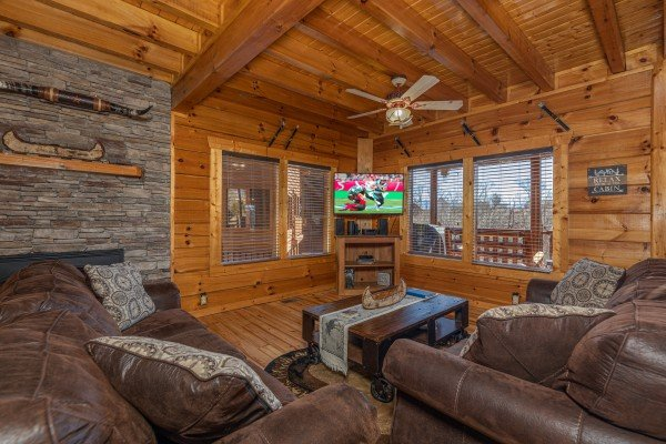 Living room with a TV at La Kiara a 3 bedroom cabin rental located in Pigeon Forge