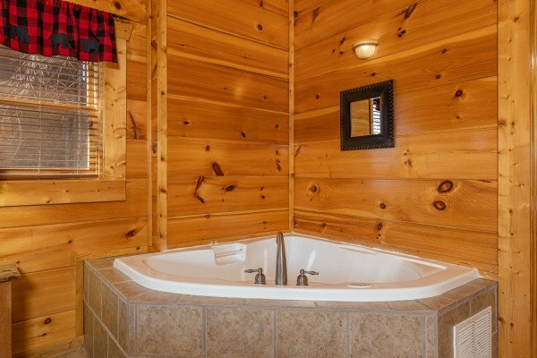 Corner jacuzzi at La Kiara a 3 bedroom cabin rental located in Pigeon Forge
