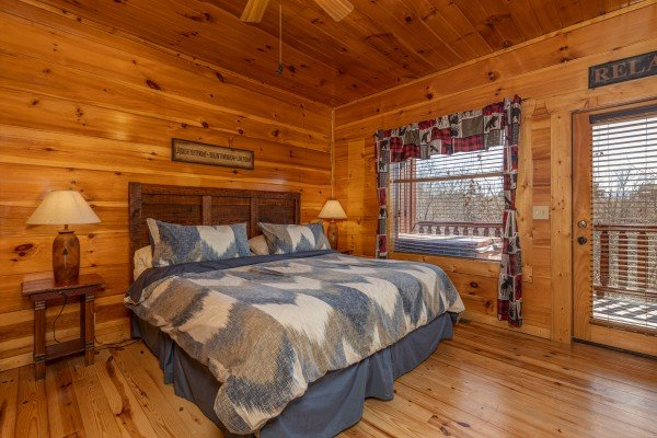 King bed, two night stands, and lamps at La Kiara a 3 bedroom cabin rental located in Pigeon Forge