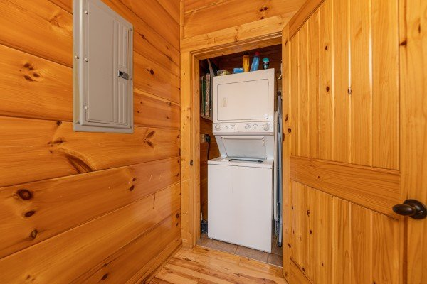 Stacked washer and dryer at La Kiara a 3 bedroom cabin rental located in Pigeon Forge