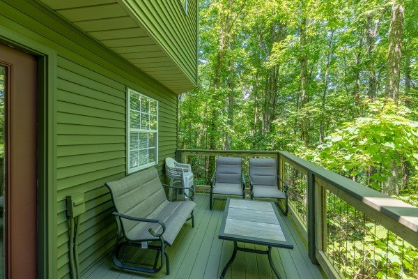 Dining space on the deck at Bearadise on Baden, a 4 bedroom cabin rental located in Gatlinburg