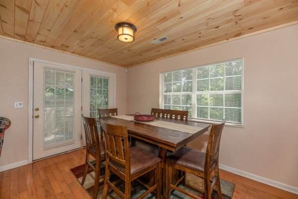 Dining room with seating for six at Bearadise on Baden, a 4 bedroom cabin rental located in Gatlinburg