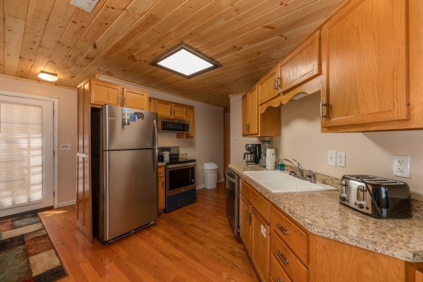 Kitchen with stainless appliances at Bearadise on Baden, a 4 bedroom cabin rental located in Gatlinburg