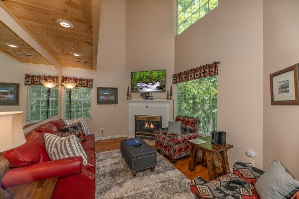 Vaulted living room with fireplace and TV at Bearadise on Baden, a 4 bedroom cabin rental located in Gatlinburg