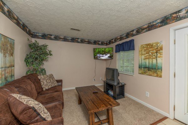 Lower living room with TV at Bearadise on Baden, a 4 bedroom cabin rental located in Gatlinburg