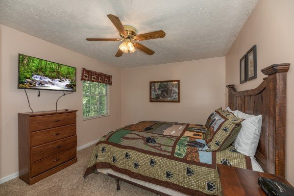 TV, dresser, and queen bed in a bedroom at Bearadise on Baden, a 4 bedroom cabin rental located in Gatlinburg