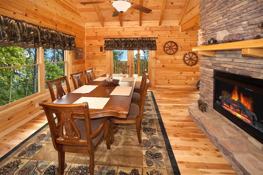 Dining area with table for eight at Log Wild! A 4 bedroom cabin rental located in Pigeon Forge