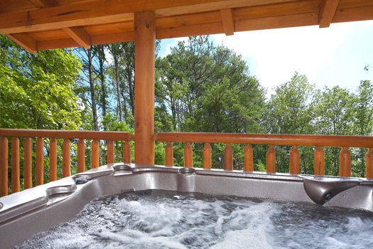 Hot tub at Log Wild! A 4 bedroom cabin rental located in Pigeon Forge