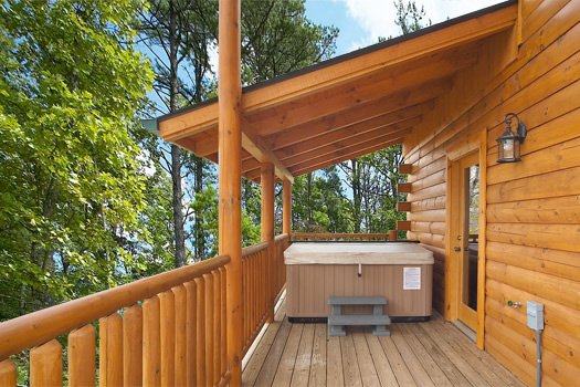 Hot tub under covered deck at Log Wild! A 4 bedroom cabin rental located in Pigeon Forge