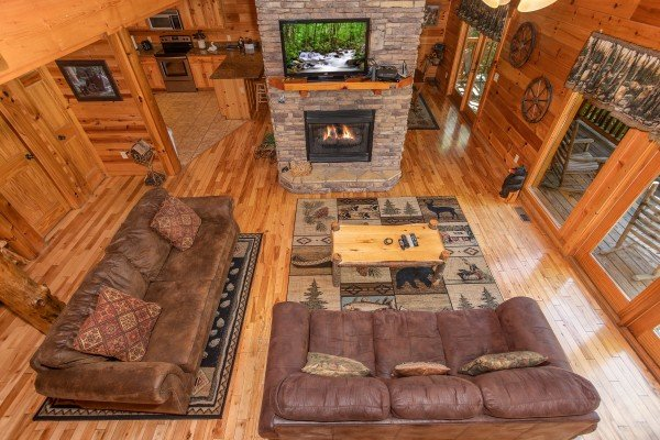 Looking down into the living room from the upper floor Log Wild! A 4 bedroom cabin rental located in Pigeon Forge