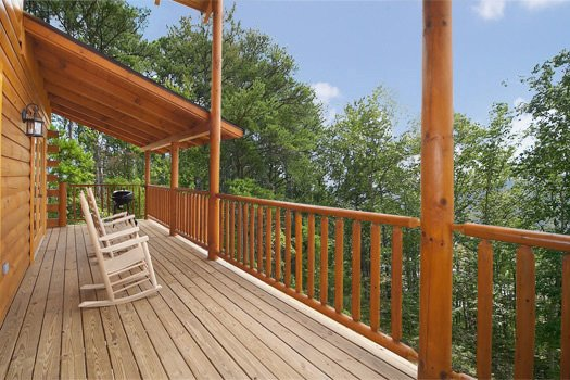 Rockers on the deck at Log Wild! A 4 bedroom cabin rental located in Pigeon Forge