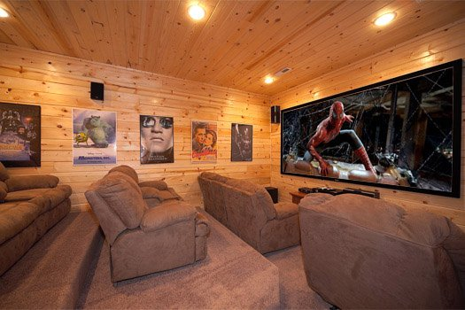 Ten foot projector screen in theater room at Log Wild! A 4 bedroom cabin rental located in Pigeon Forge
