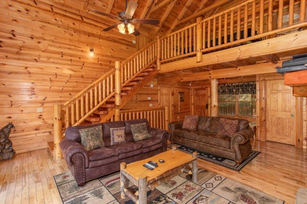 Two sofas in the living room Log Wild! A 4 bedroom cabin rental located in Pigeon Forge