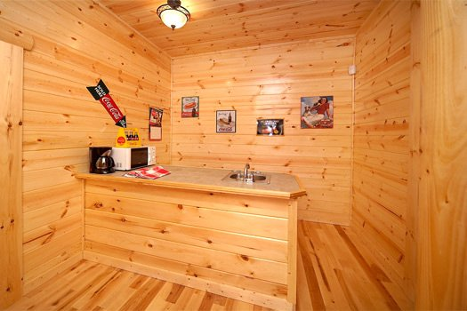 Wet bar on the first floor of Log Wild! A 4 bedroom cabin rental located in Pigeon Forge