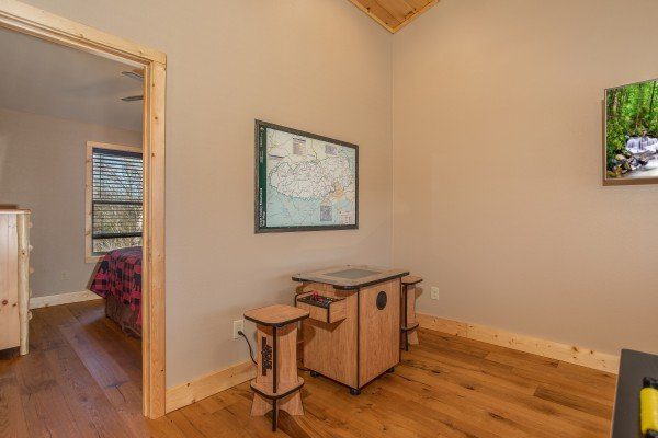 Arcade game and national park map at Wander Inn Gatlinburg, a 3 bedroom cabin rental located in Gatlinburg
