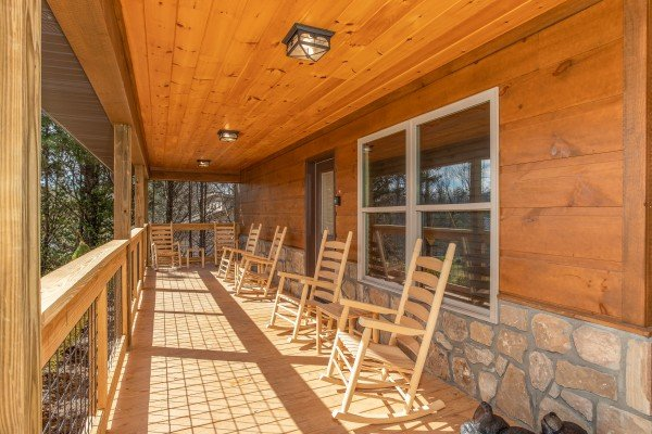 Rocking chairs on the front porch at Wander Inn Gatlinburg, a 3 bedroom cabin rental located in Gatlinburg