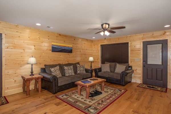 Living room with sofa and loveseat at Wander Inn Gatlinburg, a 3 bedroom cabin rental located in Gatlinburg
