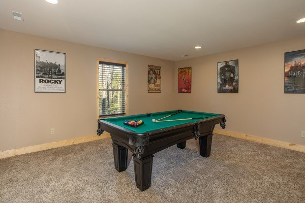Pool table in the theater room at Wander Inn Gatlinburg, a 3 bedroom cabin rental located in Gatlinburg