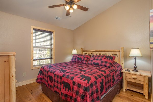 King bed with two night stands at Wander Inn Gatlinburg, a 3 bedroom cabin rental located in Gatlinburg