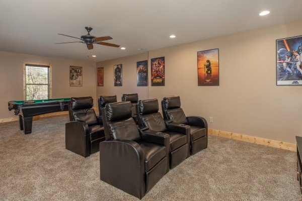Six recliners in the theater room at Wander Inn Gatlinburg, a 3 bedroom cabin rental located in Gatlinburg