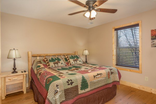 Bedroom with king bed and two nightstands at Wander Inn Gatlinburg, a 3 bedroom cabin rental located in Gatlinburg