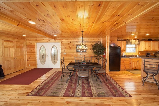 dining table next to kitchen at big sky lodge a 3 bedroom cabin rental located in gatlinburg