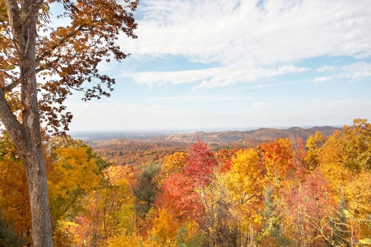 Fall foliage of Smoky Mountains seen from Big Sky Lodge, a 3-bedroom rental located in Gatlinburg