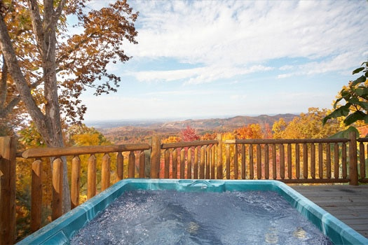 smoky mountain views from the hot tub on the deck at big sky lodge a 3 bedroom cabin rental located in gatlinburg