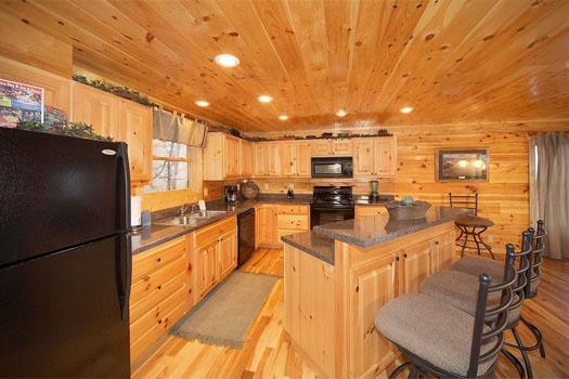 kitchen with island and barstools at big sky lodge a 3 bedroom cabin rental located in gatlinburg